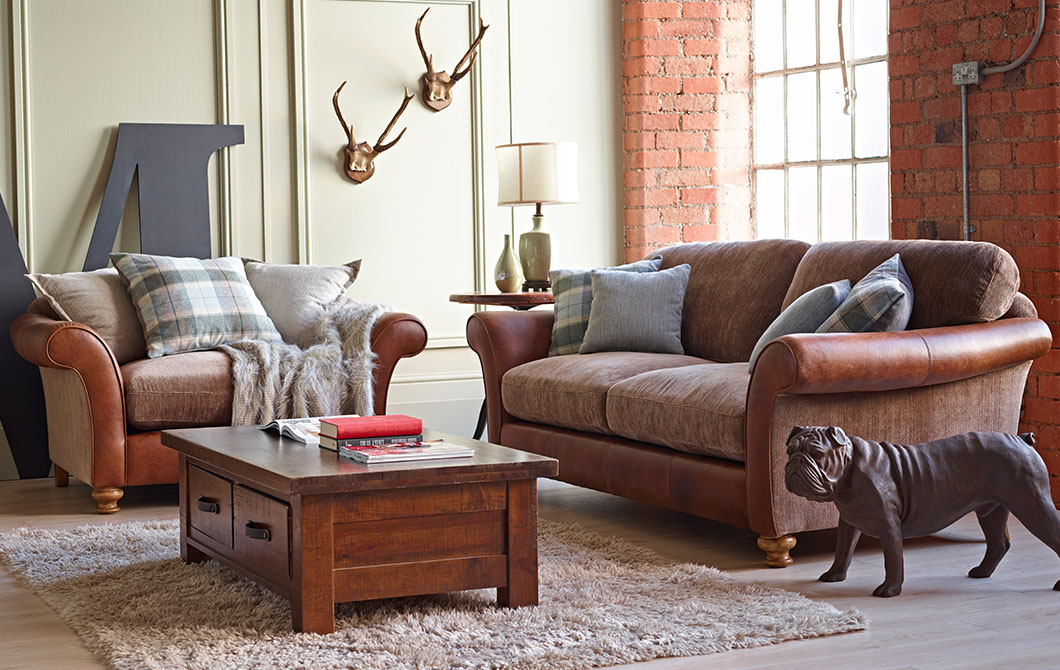 The Lawrence Love Seat has a meatier feel to it, with leather arms and big, feather filled cushions. Bigger than an armchair, but not quite a sofa, ...